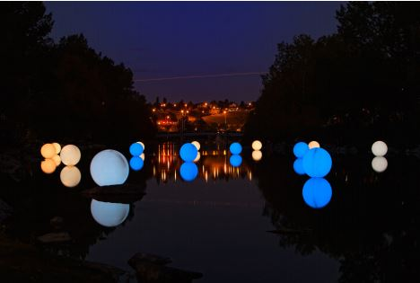 Illuminated spheres on Bow River