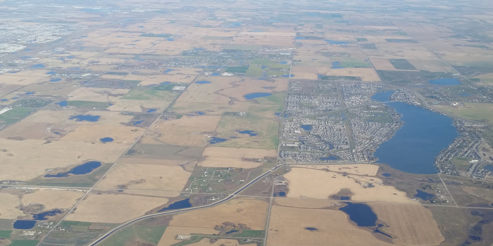 View over chestermere showing irrigation, municipal, and industry activity